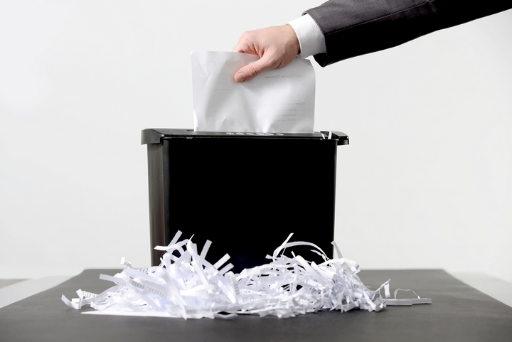 hand in paper shredder